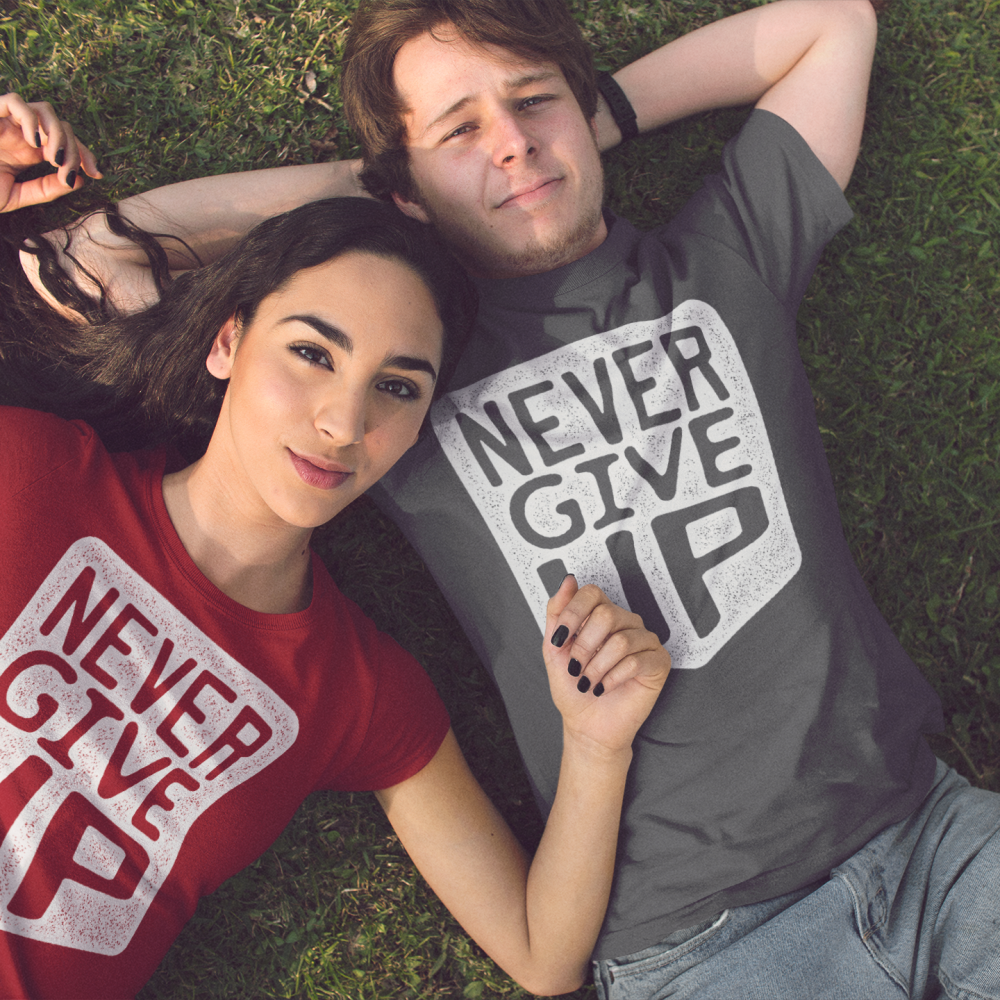 pretty-young-couple-lying-down-in-the-park-while-wearing-different-t-shirts-mockup-a15317
